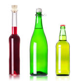 Lots bottles of various alcoholic drinks isolated — Stock Photo