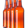Stock Photo: Row of beer Bottles isolated.