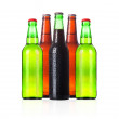 Group of Bottles of frosty beer with drops isolated — Stock Photo