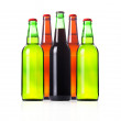 Group of Bottles with frosty light beers isolated — Stock Photo
