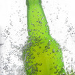 Green beer bottle splash — Stock Photo