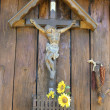 Jesus on the cross and sunflowers — Stock Photo