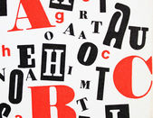 Red black white - mixture of letters — Stock Photo