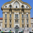 Ursuline church facade and city bus, Ljubljana — Stock Photo