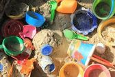 Colorful toys in a sandpit — Stock Photo