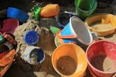 Gaily coloured toys in a sandbox — Stock Photo