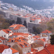Dubrovnik - red rooftops and the walled city — Stock Photo
