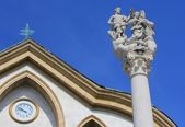 Holy Trinity sculpture and church detail, Ljubljana — Stock Photo