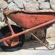 Stock Photo: Thoroughly used up wheelbarrow