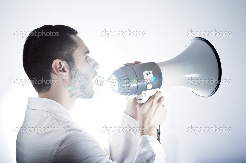 A young researcher wearing a labcoat speaking in a megaphone — Stock Photo #10920026