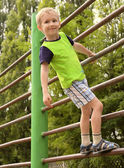 Child Boy playing on stairs playground — Foto Stock