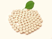 Pills medicine in shape apple with green leaf bio — Stock Photo