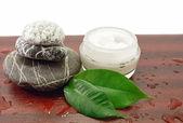 Spa stones and cosmetic cream therapy harmony — Stock Photo