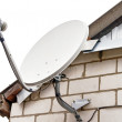Satellite dish antenna on house - Stock Photo