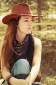 A young girl in the cowboy style — Stock Photo