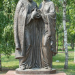 Monument to Peter and Fevronia of Murom in Irkutsk on the background of green leaves — Stock Photo