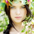 Young beautiful girl among the flowering trees — Stock Photo #11982456