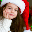 Adorable little girl in santa hat — Stock Photo