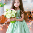 Pretty little girl in beautiful green dress with roses — Stock Photo