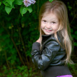 Lovely little girl in park — Foto Stock #10974048