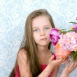 Pretty little girl in pink dress with flowers — Stock Photo