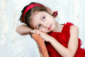 Pretty little girl in beautiful red dress — Stock Photo