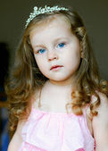 Beautiful little girl dressed as a princess with long hair — Stock Photo