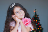Happy little girl dressed as a princess dreaming about christmas — Stock Photo