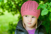 Adorable little girl in a park — Stock Photo