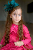 Adorable girl in turquoise hat — Stock Photo