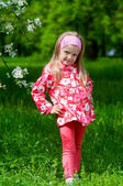 The beautiful little girl in apple tree park, smiles — Stock Photo