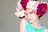 Adorable little girl with wreath from flowers — Stock Photo
