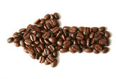 Arrow made of coffee beans — Stock Photo