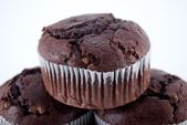 Three Stacked Double Chocolate Muffins — Stock Photo