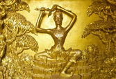 Golden Buddha stucco — Stock Photo