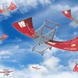 Flying shopping carts — Stock Photo