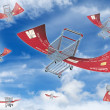Flying shopping carts - Stock Photo