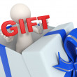 Stock Photo: 3d man in a gift box - red Gift text