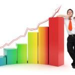 Business man - 3d rainbow financial graph — Stock Photo