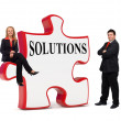 Business solutions puzzle board - Stock Photo