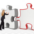 Business woman pushing big puzzle - Stock Photo