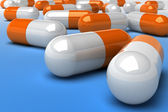 Orange pills medicine background — Foto Stock
