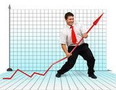 Business man fighting graph arrow — Stock Photo