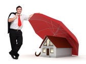House insurance - Business man - Red umbrella — Stock Photo