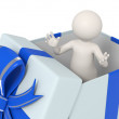 3d man in a blue gift box - Stock Photo
