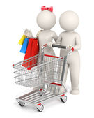 3d couple with shopping cart — Stock Photo