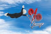 3d парень летать с покупками корзины и % знак — Стоковое фото