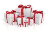 White gift boxes with red ribbons — Stock Photo