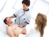 Medical assistance on young man — Stock Photo