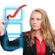 Business woman drawing a virtual red check mark — Stock Photo